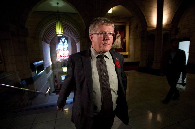 Conservative Sen. Don Plett arrives at the Senate on Parliament Hill in Ottawa on Oct. 28,