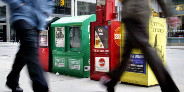 Daily newspaper boxes line the sidewalk in downtown Ottawa, April 4,