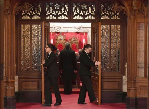 Senate pages close the doors before a vote on Bill C-45, the Cannabis Act, on Parliament Hill in Ottawa on Thursday.
