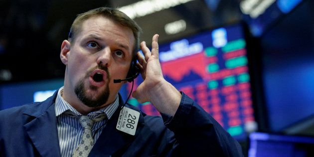 A trader works on the floor of the New York Stock Exchange in New York, N.Y., March 22. Fears of a trade...