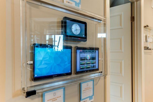A power monitor is displayed inside a zero-energy home in Guelph, Ont.