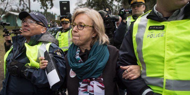 Federal Green Party Leader Elizabeth May is arrested by RCMP officers after joining protesters outside...