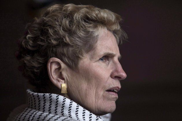 Ontario Premier Kathleen Wynne waits for Gov. Gen. Julie Payette outside the Ontario Legislature in Toronto...