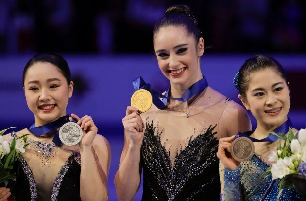 Kaetlyn Osmond of Canada, center, winner of the women's free skating program, shows her gold medal on...