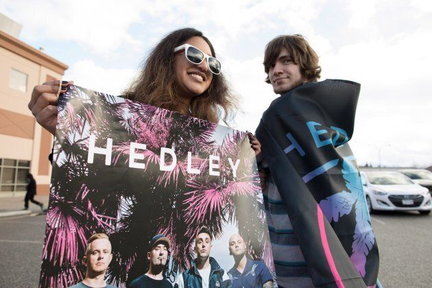 Hedley fan's Charene Gonschorek, left, and Brandon Krys show their support for the band before the final...