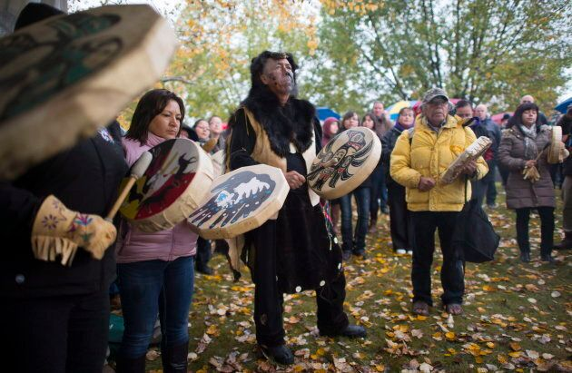 Drummers perform a song during a ceremony to commemorate the 150th anniversary of six First Nation chiefs...
