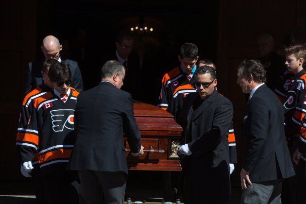 Pallbearers exit the funeral for triple homicide victims Krassimira, Roy, and Venallia Pejcinovski of...