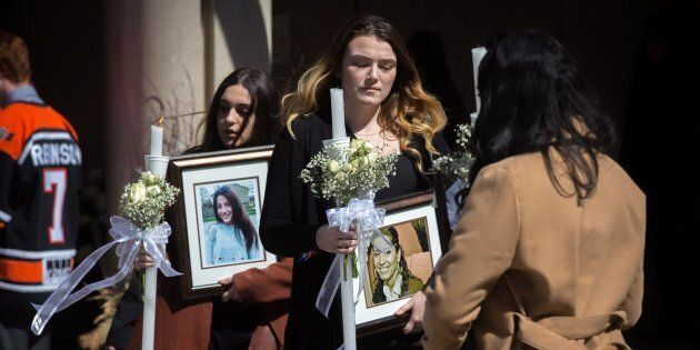 Funeral-goers exit the funeral for triple homicide victims Krassimira, Roy, and Venallia Pejcinovski...