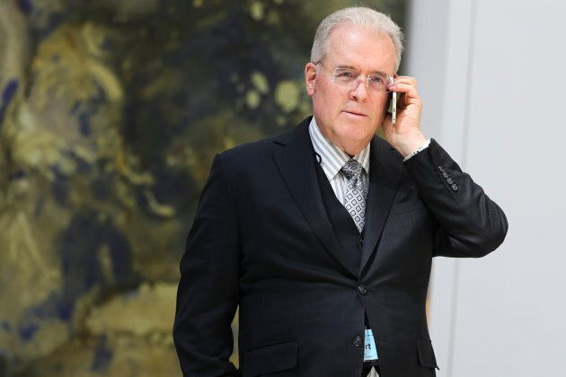 Billionaire Robert Mercer speaks on the phone during the 12th International Conference on Climate Change...