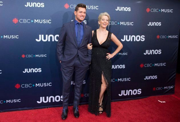 Michael Buble and wife Luisana Lopilato arrive on the red carpet at the Juno Awards in Vancouver, Sunday,...