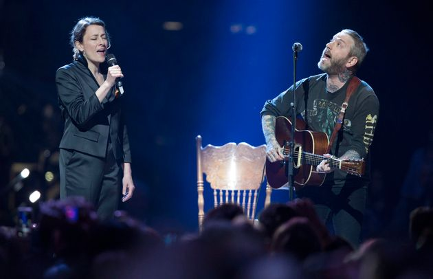 Sarah Harmer, left, and Dallas Green perform The Tragically Hip's