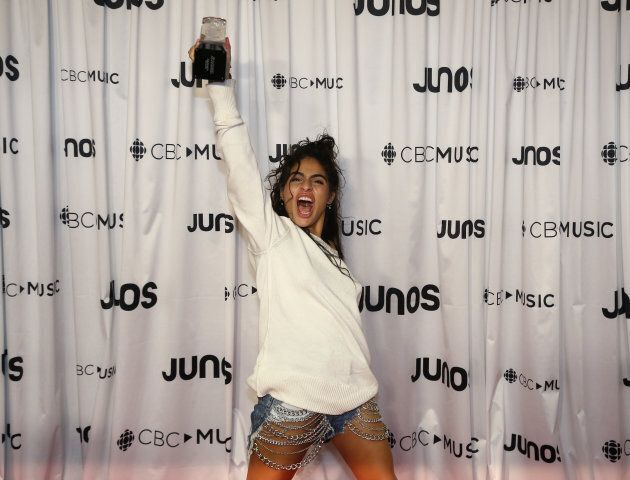 Jessie Reyez holds her breakthrough artist of the year award at the 2018 Juno