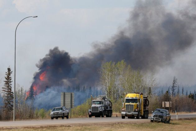 A wildfire burns near Highway 63 south of Fort McMurray, Alberta on May 8,