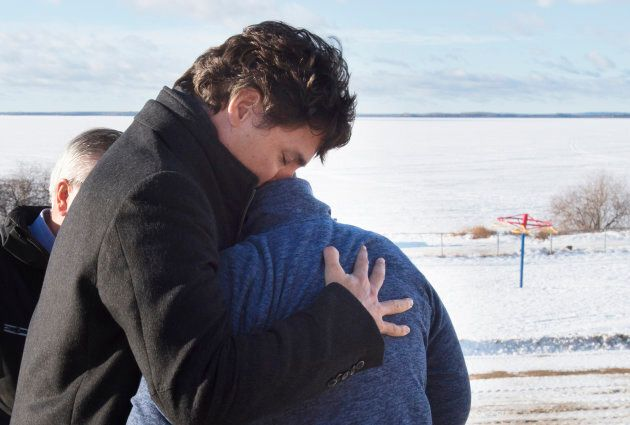Prime Minister Justin Trudeau hugs a resident in La Loche, Sask. on Jan. 29, 2016. Trudeau travelled to the site of Canada's worst mass shooting in a decade.