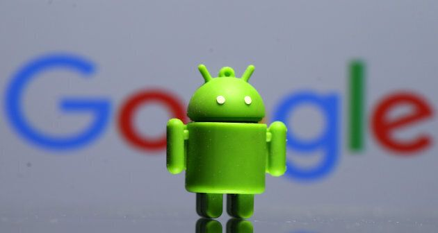 A 3D printed Android mascot Bugdroid is seen in front of a Google logo in this illustration taken July...