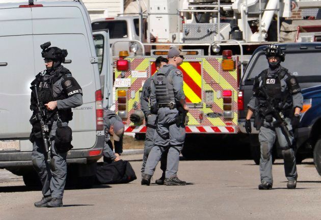 Calgary police tactical team members at the shooting scene of a police officer in Calgary on March 27,