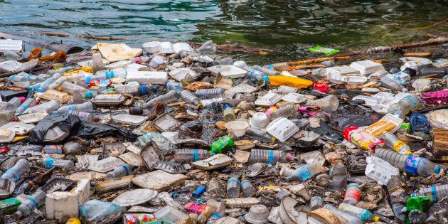 Floating garbage in the sea on the waterfront of Koh Kong, Cambodia.