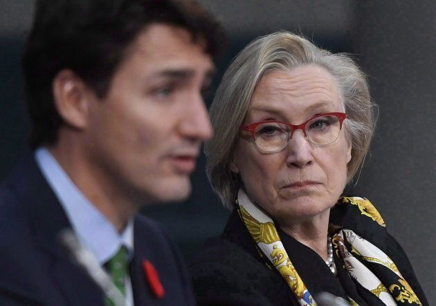 Minister of Crown-Indigenous Relations and Northern Affairs Carolyn Bennett listens as Prime Minister Justin Trudeau speaks at the Canada Modern Treaty and Self-Governing First Nations Forum, in Ottawa on Nov. 1, 2017.