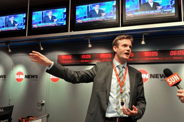 Kory Teneycke, then Vice President of Sun News television, speaks to reporters and assembled members,...