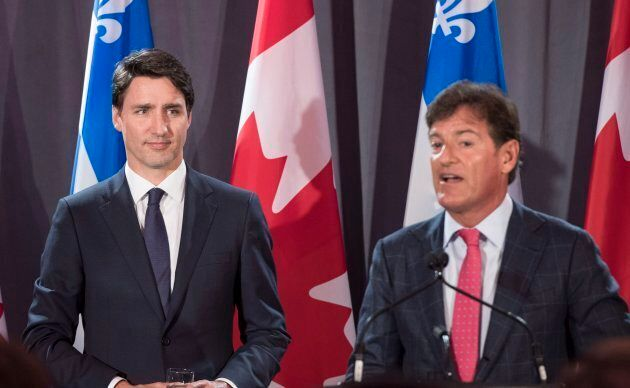 Prime Minister Justin Trudeau listens to Liberal fund raiser Stephen Bronfman at a party fundraiser on