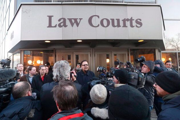 Chief Kevin Hart, centre, speaks to media outside the law courts in Winnipeg after the jury delivered...