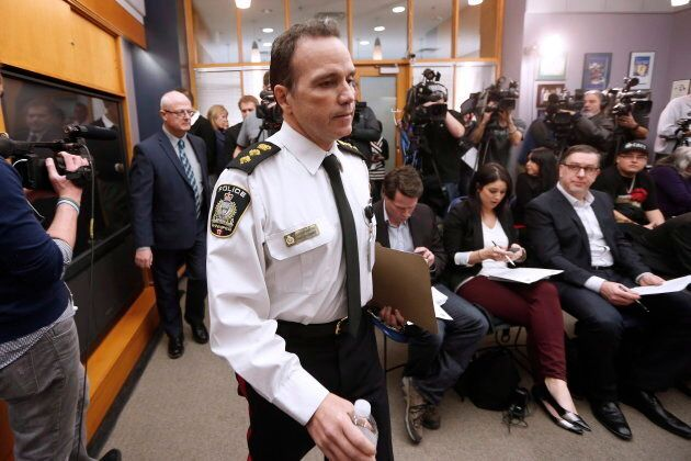 Deputy Chief Danny Smyth and Homicide Sergeant John O'Donovan, left, enter a press conference to announce...