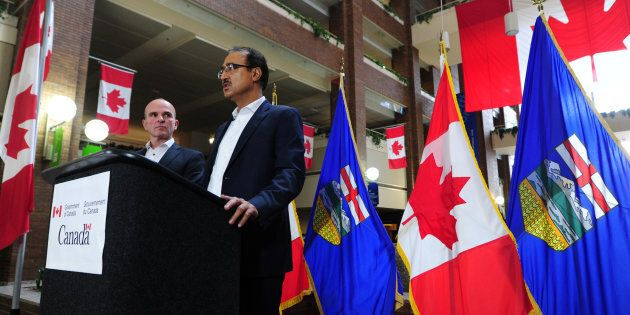 Infrastructure Minister Amarjeet Sohi and MP Randy Boissonnault hold a news conference in Edmonton on...