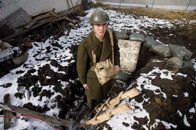 High school student Dylan Ferris pictured in the trench he built in his backyard in Edmonton on