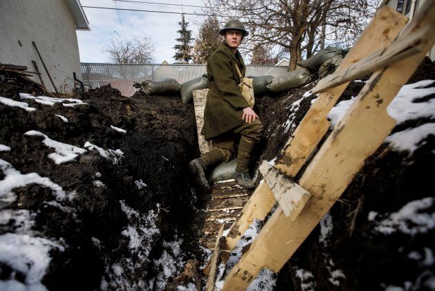 High school student Dylan Ferris pictured in the trench he built in his backyard in