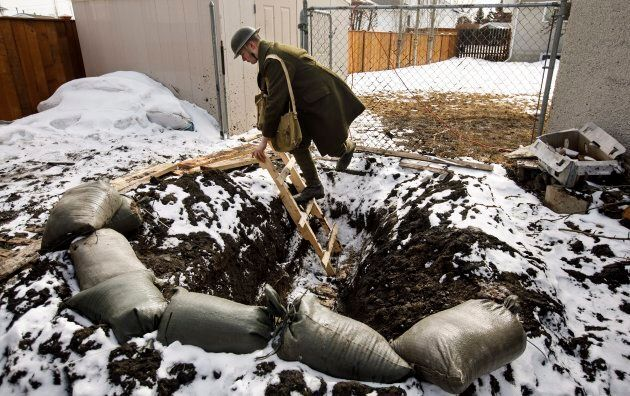 High school student Dylan Ferris pictured in the trench he built in his