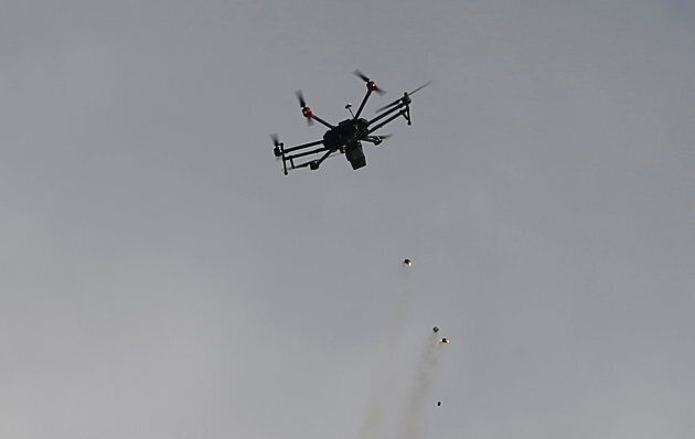 An Israeli drone drops tear gas grenades during clashes with Palestinian protesters east of Gaza City...