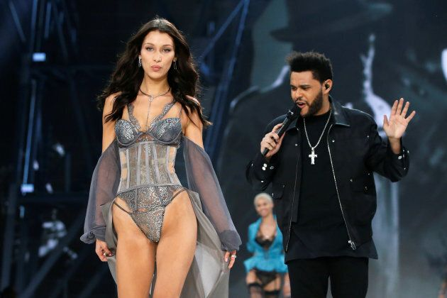Awkward: Bella Hadid walks the Victoria's Secret Fashion Show runway, while ex The Weeknd performs, at...