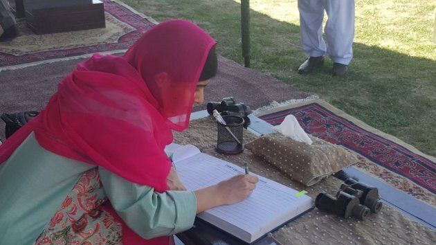 Pakistani Nobel Peace Laurette, Malala Yousafzai writes a comment in a guest book as she arrives in her...