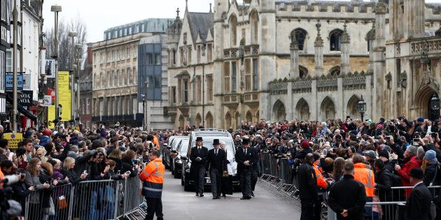 The funeral cortege arrives at Great St. Marys' Church, where the funeral of theoretical physicist Stephen...