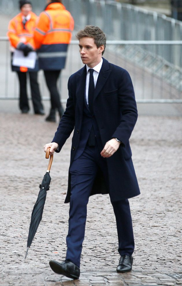 British actor Eddie Redmayne arrives at Great St. Mary's Church, where he gave a reading at the funeral...