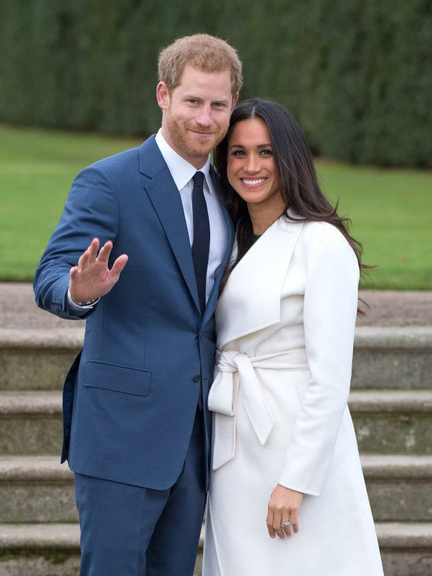 Prince Harry and Meghan Markle attend a photocall in the Sunken Gardens at Kensington Palace following...