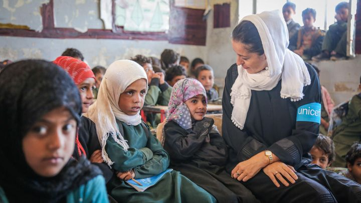 On 27 March 2018 in the Aldailami School, Belad Alroos district, Sana'a, Yemen, UNICEF Representative in Yemen Merixell Relano (with white scarf) speaks with girl students. Nearly half a million children have dropped out of school since the 2015 escalation of conflict in Yemen, bringing the total number of out-of-school children to 2 million.