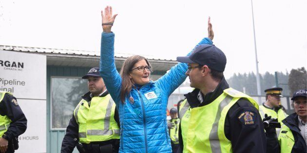 Environmental engineer Romilly Cavanaugh is arrested at a protest against Kinder Morgan's expansion of...