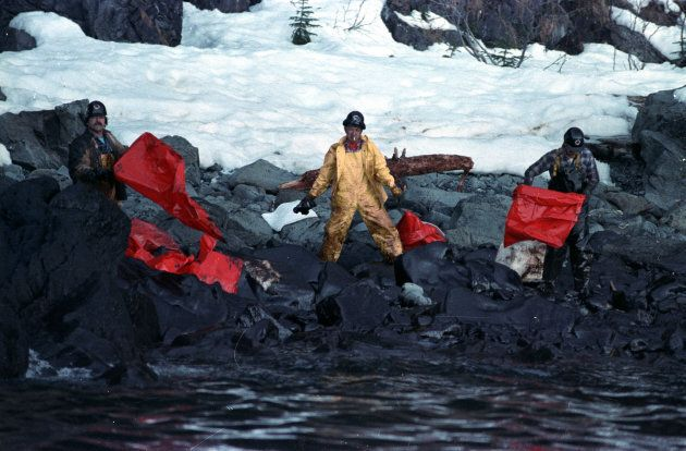Crews clean up the oil soaked beach on Naked Island in the Prince William Sound off the coast of Alaska on April 2, 1989 after the Exxon Valdez oil spill.