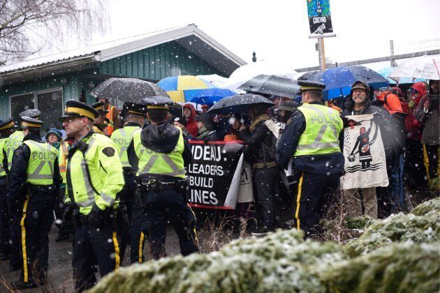 Demonstrators gather outside Kinder Morgan's Burnaby Mountain facility in B.C. Hundreds have been arrested for violating a court injunction ordering protesters to stay at least five metres away from Kinder Morgan's gates.