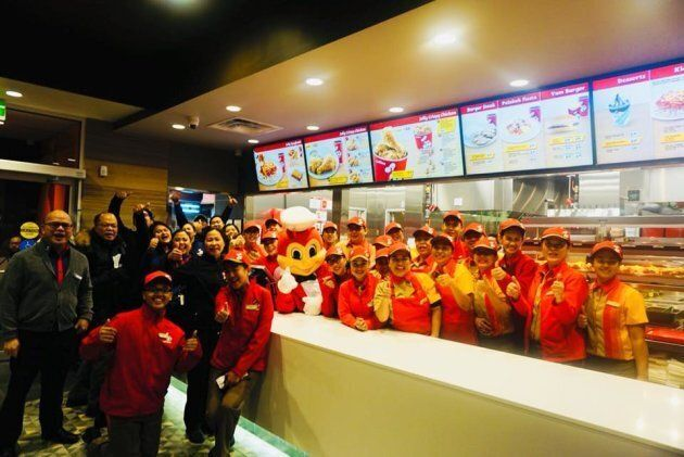 Staff at a Winnipeg location of Jollibee pose for a photo posted to the chain's Facebook
