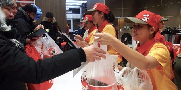 Staff at a Jollibee location in Winnipeg, in a picture posted to Jollibee's Facebook page, Dec. 15,