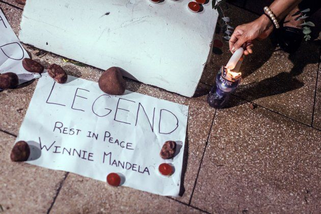 A message is left near the Old Durban Prison's Human Rights wall as South Africans gather to pay their respects to the late high-profile anti-apartheid activist Winnie Madikizela-Mandela during a candle vigil in Durban on April 2, 2018.