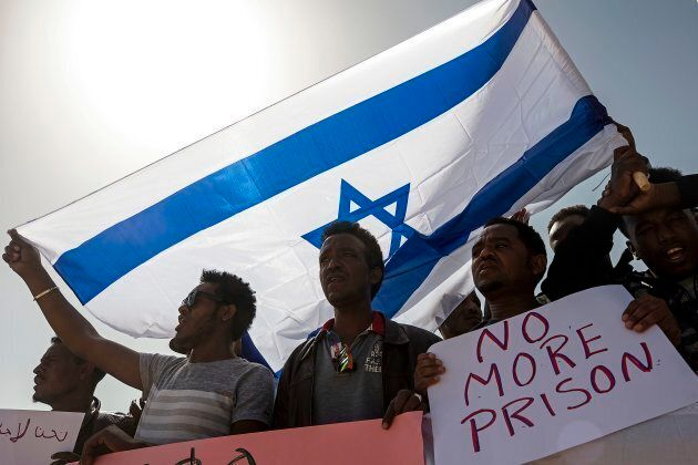 In this February, 2018 file photo, asylum seekers march during a protest outside Israeli Prison Saharonim,...
