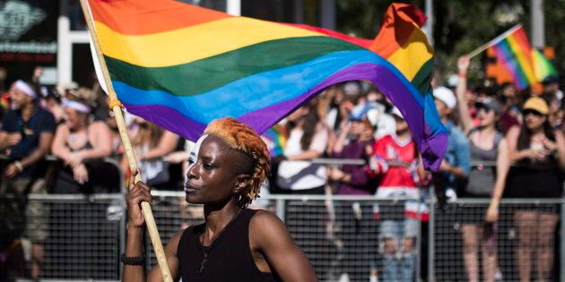 A woman holds a flag during the Pride parade in Toronto on June 25,