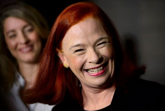 Catherine Tait smiles as Heritage Minister Melanie Joly announces that Tait is the new president and...