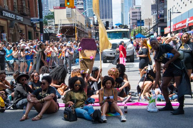 Members of Black Lives Matter sit and block the Pride Parade from the normal parade