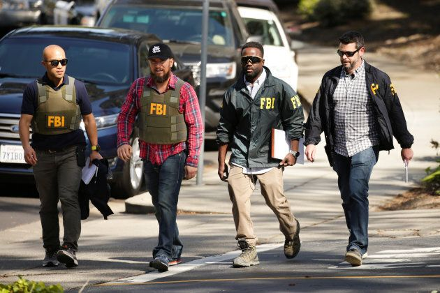 FBI agents are seen near Youtube headquarters following an active shooter situation in San Bruno, California...