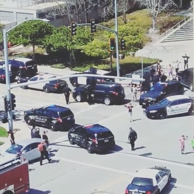 Officials are seen following a shooting at the headquarters of YouTube, in San Bruno, Calif. on April...