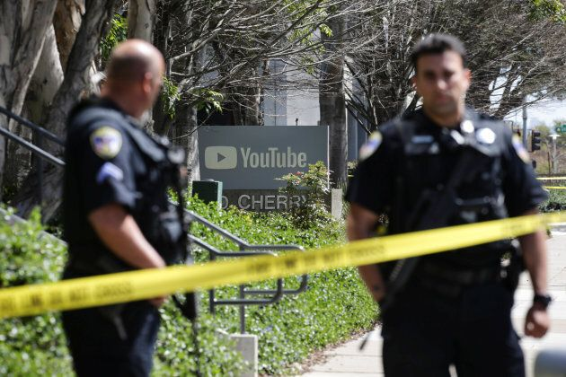 Police officers and crime scene tape are seen at Youtube headquarters following an active shooter situation...